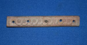 An expertly carved and decorated main body section from a Roman bone hair comb, London. SOLD